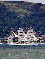 Portugal-registered, Sagres, a 3-masted barque departs Belfast, N Ireland, UK, at the end of the Belfast Maritime Festival in August 2009. It is sailing  down Belfast Lough with the Cave Hill, Co Antrim, in the background. 200908163004.<br />