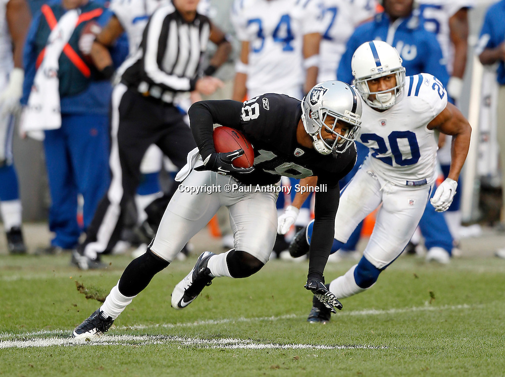 Oakland Raiders wide receiver Louis Murphy (18) keeps his balance after catching a first down pass in Indianapolis Colts territory while covered by Indianapolis Colts cornerback Justin Tryon (20) during the NFL week 16 football game on Sunday, December 26, 2010 in Oakland, California. The Colts won the game 31-26. (©Paul Anthony Spinelli)