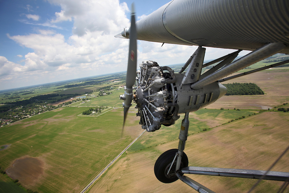 A 1929 Ford Tri-Motor fly's around Muncie Thursday afternoon. The airplane is one of only 199 that were built and one of several still flying today. This specific airplane was featured in the recent movie Public Enemies. .(Chris Bergin/ The Star Press)