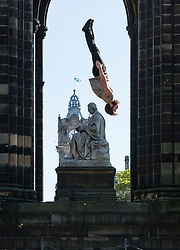 Manu Tiger from Tiger Circus is propelled into the air above Edinburgh by Massimilliano Rossetti of Lost in Translation Circus for their co-production, Attached, at the Edinburgh Fringe Festival;