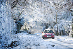© Licensed to London News Pictures. 30/01/2019. Butlers Cross, UK.  A car drives in icy conditions, through a snow covered landscape in Butlers Cross, Buckinghamshire, as snow hits the south east of England. Photo credit: Ben Cawthra/LNP