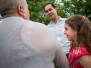 14 JUNE 2019 - WAUKEE, IOWA: JULIÁN CASTRO, Democratic presidential candidate and former Secretary of Housing and Urban Development during the Obama administration, talks to residents of Midwest County Estates, a mobile home community in Waukee, a suburb of Des Moines, Friday. Castro met with residents of the community to talk about affordable housing. Mobile County Estates was sold in March and the new owners are trying to hike rents for lots in the community by 69%, an amount residents say they can't afford. Castro is visiting Iowa to support his candidacy for the Democratic ticket of the US Presidency. Iowa traditionally hosts the the first selection event of the presidential election cycle. The Iowa Caucuses will be on Feb. 3, 2020.                                  PHOTO BY JACK KURTZ