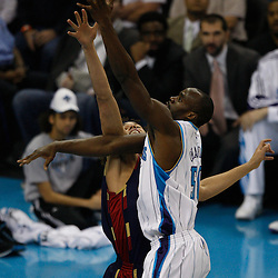 Mar 24, 2010; New Orleans, LA, USA; New Orleans Hornets center Emeka Okafor (50) shoots over Cleveland Cavaliers forward Anderson Varejao (17)during the first half at the New Orleans Arena. Mandatory Credit: Derick E. Hingle-US PRESSWIRE