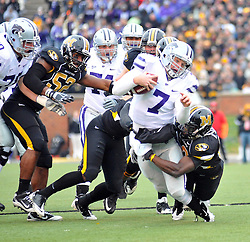 Nov 13, 2010; Columbia, MO, USA; Kansas State Wildcats quarterback Collin Klein (7) is tackled by Missouri Tigers safety Kenji Jackson (13) and defensive lineman Michael Sam (52) in the first half at Memorial Stadium. Mandatory Credit: Denny Medley-US PRESSWIRE
