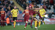 Greg Leigh (Bradford) gets to the ball just ahead of Sam Youngs (Chesham) during the The FA Cup match between Bradford City and Chesham FC at the Coral Windows Stadium, Bradford, England on 6 December 2015. Photo by Mark P Doherty.