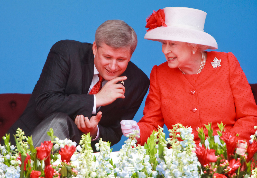 Queen Elizabeth II talks with Canadian Prime Minister Stephen Harper during Canada Day celebrations on Parliament Hill in Ottawa, Ontario, July 1, 2010. The Queen is on a 9 day visit to Canada. .AFP/GEOFF ROBINS/STR