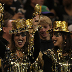 16 January 2010:  New Orleans Saints fans cheer from the stands during a 45-14 win by the New Orleans Saints over the Arizona Cardinals in the 2010 NFC Divisional Playoff game at the Louisiana Superdome in New Orleans, Louisiana.