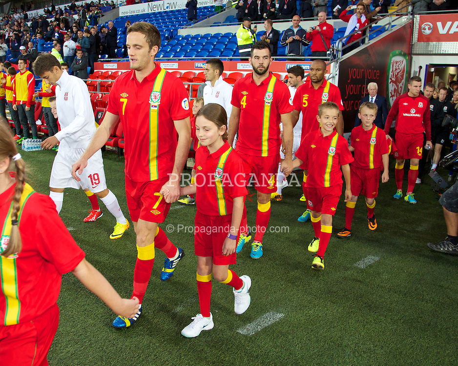 CARDIFF, WALES - Tuesday, September 10, 2013: Wales' Andy King walks out to face Serbia during the 2014 FIFA World Cup Brazil Qualifying Group A match at the Cardiff CIty Stadium. (Pic by David Rawcliffe/Propaganda)
