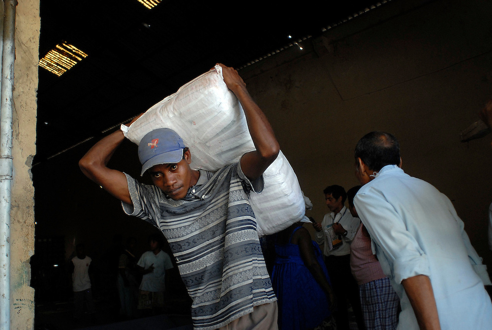 Mobs of desperate people loot a warehouse in Dili, stealing agricultural machinery, bags of grain and fertilizer. 060606
