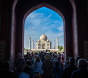 Tourists gather in front of the famous mausoleum Taj Mahal, Agra, Uttar Pradesh, India.
