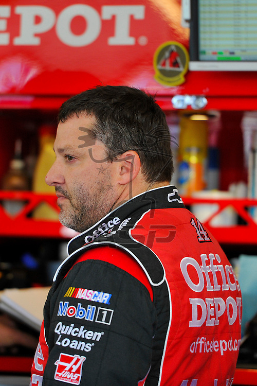 Joliet, IL - SEP 14, 2012: Tony Stewart (14) stands in the garage during practice for the Geico 400 at the Chicagoland Speedway in Joliet, IL.