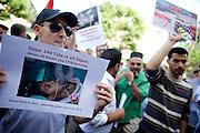Mainz | 18 July 2014<br /> <br /> Am Samstag (18.07.2014) nahmen etwa 1000 M&auml;nner, Frauen und Kinder in der Innenstadt von Mainz anl&auml;sslich der milit&auml;rischen Auseinandersetzung zwischen Israel und der Hamas in Gaza an einer Solidarit&auml;tsdemonstration f&uuml;r Gaza, ein freies Pal&auml;stina und gegen Israel teil. Bei der Demo wurden Fahnen der Hamas und der Hisbollah mitgef&uuml;hrt, neben den &uuml;blichen Parolen gegen Israel wurde in Sprechch&ouml;hren auch vereinzelt zur Vernichtung von J&uuml;dinnen und Juden aufgerufen.<br /> Hier: Ein Mann h&auml;lt ein Foto eines vermutlich in den letzten Tagen bei der milit&auml;rischen Auseinandersetzung zwischen Israel und der Hamas get&ouml;teten Kindes.<br /> <br /> <br /> &copy;peter-juelich.com<br /> <br /> [No Model Release | No Property Release]