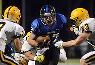 Quakertown's Noah Wood #27 drives into the end zone for a touchdown as Central Bucks Jake Reichwein #33 and Zane Williams (left) attempt to stop him in the second quarter Friday September 9, 2016 in Quakertown, Pennsylvania. (Photo by William Thomas Cain)