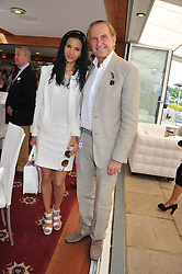 GEOFFREY KENT and his wife OTAVIA at the Audi International Polo Day held at Guards Polo Club, Smith's Lawn, Windsor on 22nd July 2012.