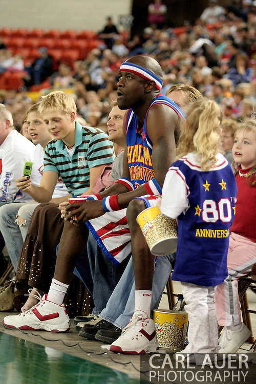 """04 May 2006: Kevin """"Special K"""" Daley watches the action while sitting on a fan at the Harlem Globetrotters vs the New York Nationals at the Sulivan Arena in Anchorage Alaska during their 80th Anniversary World Tour.  This is the first time in 10 years that the Trotters have visited Alaska."""