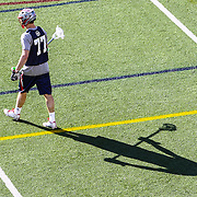 Kyle Sweeney #77 of the Boston Cannons warms up on the field prior to the game at Harvard Stadium on May 17, 2014 in Boston, Massachuttes. (Photo by Elan Kawesch)