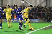 Dannie Bulman of AFC Wimbledon gets the better of Ollie Clarke of Bristol Rovers during Sky Bet League 2 match between AFC Wimbledon and Bristol Rovers at the Cherry Red Records Stadium, Kingston, England on 26 December 2015. Photo by Stuart Butcher.