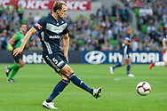 Melbourne Victory defender George Niedermeier (5) passes the ball at the Hyundai A-League Round 4 soccer match between Melbourne Victory and Central Coast Mariners at AAMI Park in Melbourne.
