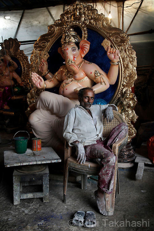 An artist sits in front of Idols of Lord Ganesh at workshop in Mumbai, India on Sep 9, 2010 during a preparation of the Ganpati festival which starts on Sep 11. The 10-day-long Hindu festival, celebrating the birthday of Lord Ganesha who is widely worshiped as the god of wisdom, prosperity and good fortune, attracts tens of thousands people every year..Photo by Kuni Takahashi