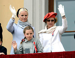 Queen Sonja of Norway, Crown Princess Mette-Marit of Norway,  Princess Ingrid Alexandra watch the annual Norwegian National Day parade from the balcony of The Royal Palace in Oslo, Norway. May 17, 2013. Photo by: Schneider-Press / i-Images. UK & USA ONLY