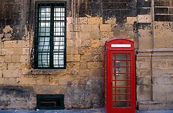 MALTA VALETTA JUL00 - A red telephone box, a gentle reminder of Malta's colonial past with the British.....jre/Photo by Jiri Rezac....© Jiri Rezac 2000....Tel:   +44 (0) 7050 110 417..Email: info@jirirezac.com..Web:   www.jirirezac.com