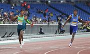 May 12, 2019; Yokohama, JPN; Paulo Andre Camilo de Oliveira (BRA), left, edges Noah Lyles (USA) on the anchor of the 4 x 100m relay, 38.05 to 38.07,  during the IAAF World Relays at International Stadium Yokohama.