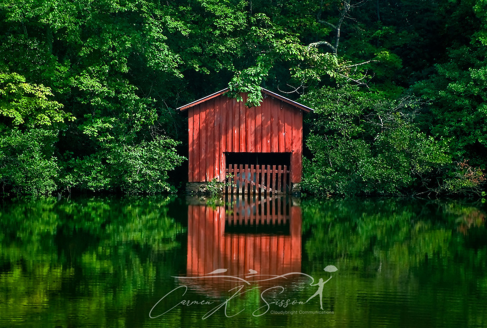A red boathouse is reflected in the waters of Little River at DeSoto Falls Aug. 5, 2010 in Mentone, Ala. The area features a 104-foot waterfall and is part of DeSoto State Park, which was created by the Civilian Conservation Corps in the 1930s atop scenic Lookout Mountain in northeast Alabama. (Photo by Carmen K. Sisson/Cloudybright)