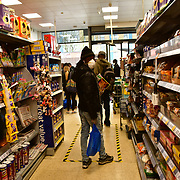 During the coronavirus in UK lockdown I seen mostly are Asian people and Security in the front-line to serve the people need of food or shopping and Tesco will be remind open troughout, at Walthamstow Square,on 28 March 2020 London.