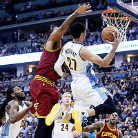 22 March 2017: Denver Nuggets guard Jamal Murray (27) goes for the reverse layup against Cleveland Cavaliers forward Channing Frye (8) during the Denver Nuggets 126-113 victory over the Cleveland Cavaliers, at the Pepsi Center, Denver, Colorado, USA.