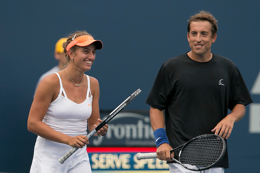 August 22, 2014, New Haven, CT:<br /> Jacqueline Cako and Joel Kielbowicz high five each other during a US Open National Playoffs semi-final mixed doubles match against Nicole Melichar and Patrick Smith on day eight of the 2014 Connecticut Open at the Yale University Tennis Center in New Haven, Connecticut Friday, August 22, 2014.<br /> (Photo by Billie Weiss/Connecticut Open)
