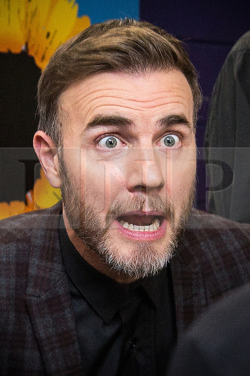 "© Licensed to London News Pictures . 12/01/2016 . Salford , UK . GARY BARLOW backstage after making a surprise appearance at the Lowry Theatre ,  during the opening week of "" The Girls "" , a musical he wrote based on the story "" Calendar Girls "" , about a group of Women's Institute members in Yorkshire , who made a nude calendar . Photo credit : Joel Goodman/LNP"