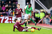 John Souttar (#4) of Heart of Midlothian slides in on Efe Ambrose (#25) of Hibernian during the William Hill Scottish Cup 4th round match between Heart of Midlothian and Hibernian at Tynecastle Stadium, Gorgie, Scotland on 21 January 2018. Photo by Craig Doyle.