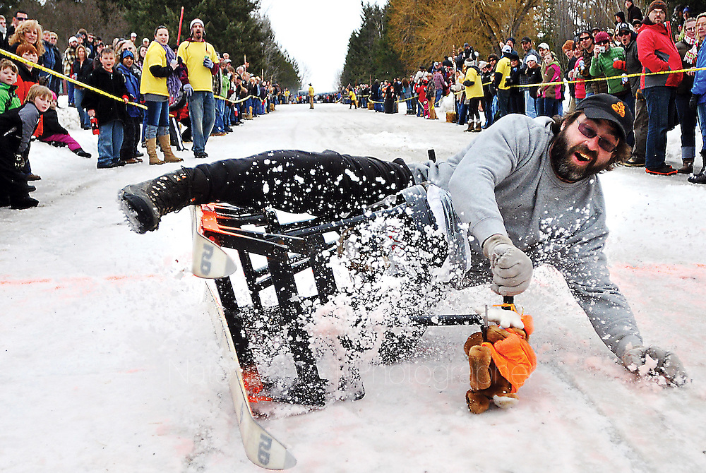 Wade Kelch wipes out after crossing the finish line during Bar Stool Races at the 33rd Cabin Fever Days in Martin City on Saturday, February 12, 2011. The event continues today with more activites ranging from Turtle Races to a Mountain Man Contest. (Nate Chute/Daily Inter Lake)