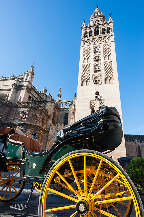 La Giralda tower over horse carriage in Sevilla (Spain)
