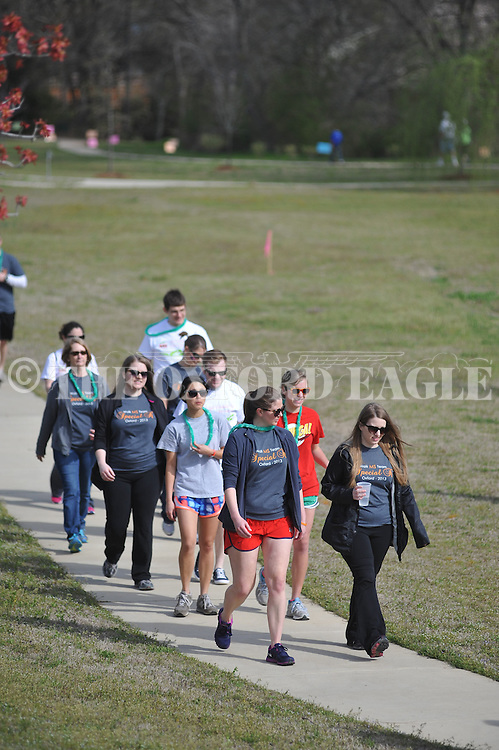 Participants walk as part of a fundraiser during the Alabama-Mississippi Chapter of the National Multiple Sclerosis Society's Oxford Walk MS in Oxford, Miss. on Saturday, April 6, 2013.