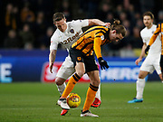 Adam Forshaw of Leeds United and Jackson Irvine of Hull City contest a loose ball during the EFL Sky Bet Championship match between Hull City and Leeds United at the KCOM Stadium, Kingston upon Hull, England on 30 January 2018. Photo by Paul Thompson.