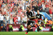 Nottingham Forest midfielder Henri Lansbury (10) celebrates scoring a goal scores a goal 2-2 during the EFL Sky Bet Championship match between Aston Villa and Nottingham Forest at Villa Park, Birmingham, England on 11 September 2016. Photo by Jon Hobley.