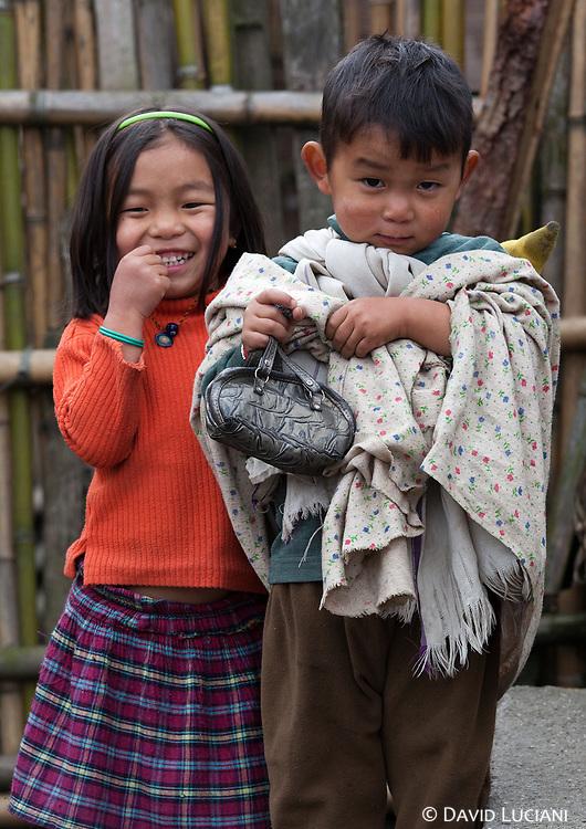 Two kids posing for the camera in Tajang and Bulla Lemba area.
