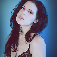 Sexy young female with black hair and blue eyes in underwear