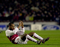 Photo: Greig Cowie<br />Champions League Second Group Stage. Group B Arsenal v Ajax. 18/02/2002<br />Thierry Henry picks himself up after a disapointing night
