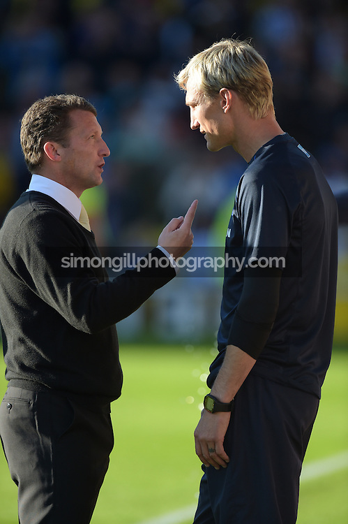 04.10.2014.  Watford, England. Billy McKinlay and Sami Hyypia after the Skybet Championship game Watford versus Brighton and Hove Albion.