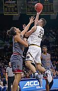 SOUTH BEND, IN - JANUARY 12: John Mooney #33 of the Notre Dame Fighting Irish shoots the ball against Johncarlos Reyes #12 of the Boston College Eagles at Purcell Pavilion on January 12, 2019 in South Bend, Indiana. (Photo by Michael Hickey/Getty Images) *** Local Caption *** John Mooney; Johncarlos Reyes