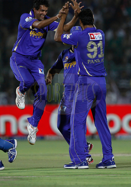 Rajasthan Royals player Pankaj Singh celebrates the wicket of Royal Challengers Bangalore player Virat Kohli during match 30 of the the Indian Premier League ( IPL) 2012  between The Rajasthan Royals and the Royal Challengers Bangalore held at the Sawai Mansingh Stadium in Jaipur on the 23rd April 2012..Photo by Pankaj Nangia/IPL/SPORTZPICS