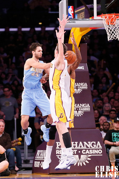 05 January 2014: Denver Nuggets shooting guard Evan Fournier (94) passes the ball while in the air during the Denver Nuggets 137-115 victory over the Los Angeles Lakers at the Staples Center, Los Angeles, California, USA.
