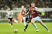 Charlie Taylor (#3) of Burnley and Christian Atsu (#30) of Newcastle United contest the ball during the Premier League match between Newcastle United and Burnley at St. James's Park, Newcastle, England on 31 January 2018. Photo by Craig Doyle.