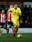 Milton Keynes Dons striker Sam Gallagher powering away from Brentford midfielder Ryan Woods during the Sky Bet Championship match between Brentford and Milton Keynes Dons at Griffin Park, London, England on 5 December 2015. Photo by Matthew Redman.