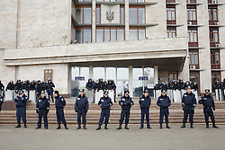 © Licensed to London News Pictures. 05/03/2014. Ukraine, Riot police guard the administrative building in Donetsk during a demonstration involving groups of pro-Russia and anti-Putin protestors, in the wake of events in Kyiv. Photo credit : Christopher Nunn/LNP
