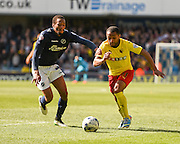 Ikechi Anya takes on Shaun Cummings during the Sky Bet Championship match between Millwall and Watford at The Den, London, England on 11 April 2015. Photo by David Charbit.
