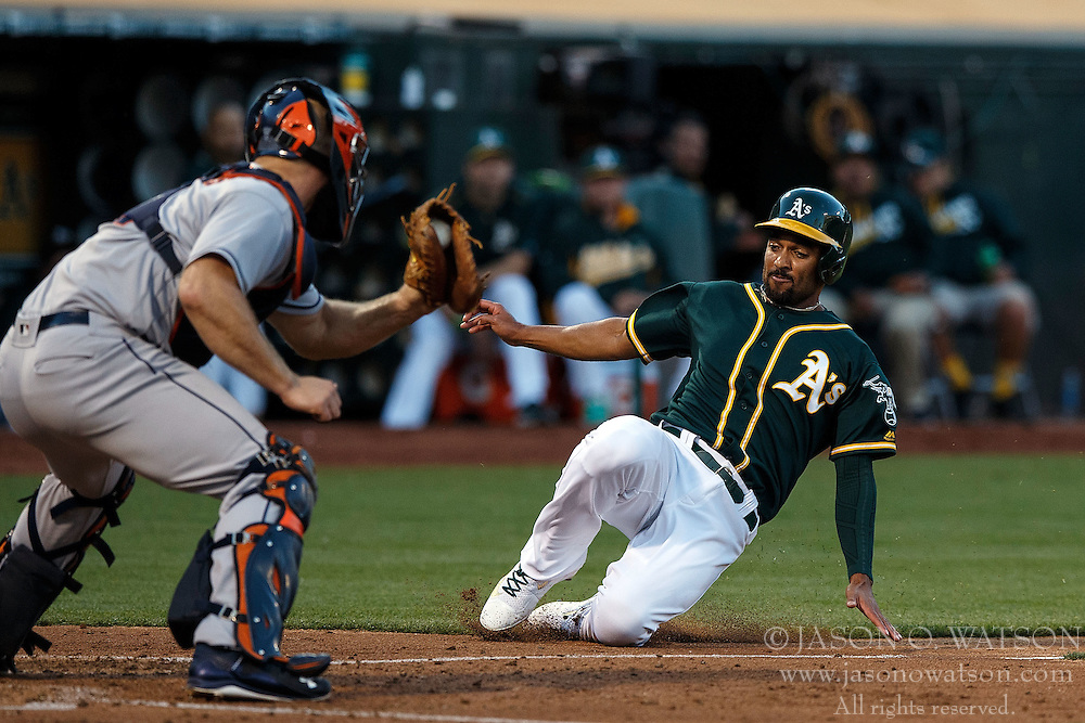 OAKLAND, CA - JULY 19:  Marcus Semien #10 of the Oakland Athletics is tagged out at home plate by Evan Gattis #11 of the Houston Astros during the second inning at the Oakland Coliseum on July 19, 2016 in Oakland, California. The Oakland Athletics defeated the Houston Astros 4-3 in 10 innings.  (Photo by Jason O. Watson/Getty Images) *** Local Caption *** Marcus Semien; Evan Gattis