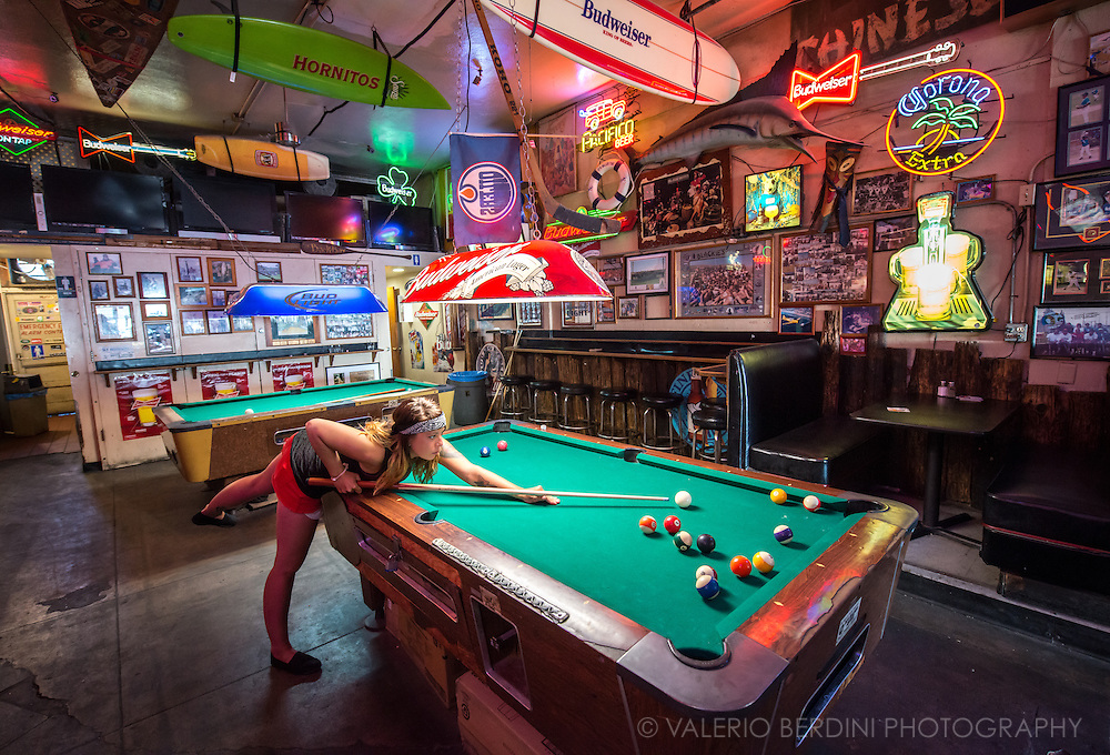 Blackie's By the Sea is an unfussy, cash-only mainstay draws a mixed crowd for draft beer, billiards & sports on TV. Newport Beach, California.